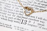 Gold necklace with heart on the Bible
