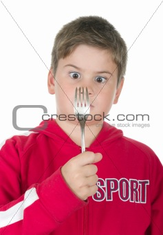 Boy looks at a fork