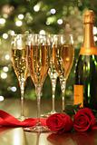 Glasses of Champagne with red roses