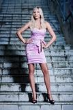 attractive blond girl at stairs