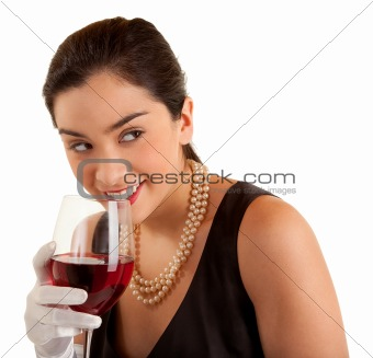 Woman Holding Glass of Wine Looking Sideways