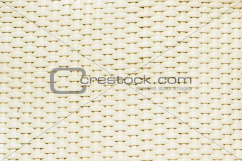Background made of woven reddish plastic stripes