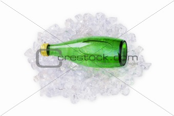 Green bottle of water on ice cubes