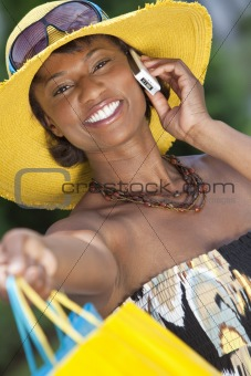 African American Woman With Fashion Shopping Bags on Cell Phone