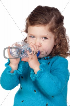 Beautiful baby girl with drinking with a water bottle