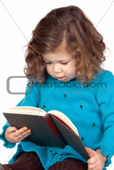 Smiling baby girl reading a book