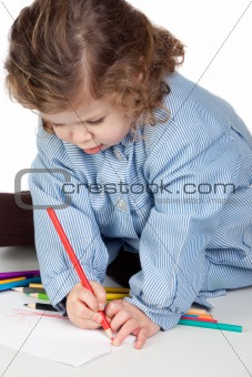 Beautiful girl painting with preschool uniform