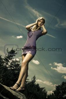 blond girl in purple dress