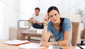 Worried woman doing her accounts
