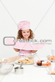 Little girl presenting her cookies homemade