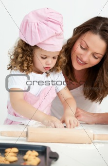 Little girl preparing a daught with her mother