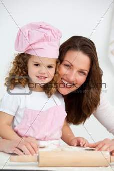Portrait of a mother and daughter at a table