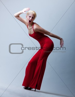 attractive screaming girl in red dress
