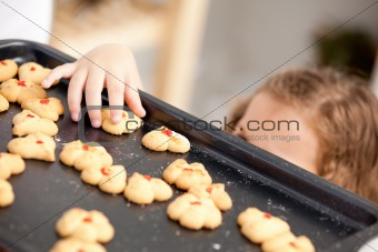 Close up of a little girl taking a cookie