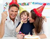 Portrait of a family celebrating little boy's birthday