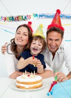 Portrait of a family celebrating little boy