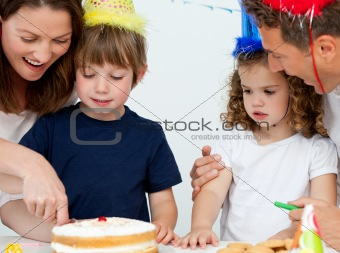 Mom and son cutting a birthday cake together