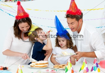 Beautiful mom serving a birthday cake to her family