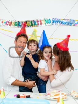 Portrait of parents with their children during a birthday party