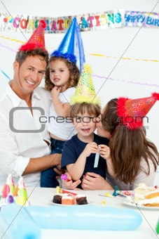 Portrait of a happy family during a birthday party