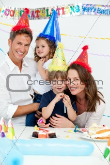 Portrait of cute children with their parents during a birthday
