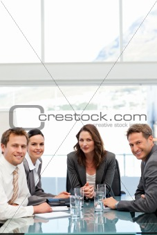 Confident businesswoman with her team at a table
