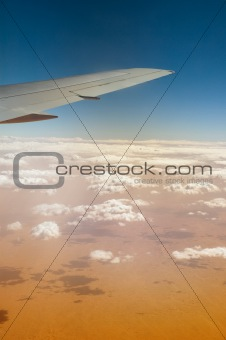 Airplane over Sahara desert