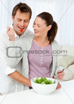 Pretty woman giving a tomato to her boyfriend
