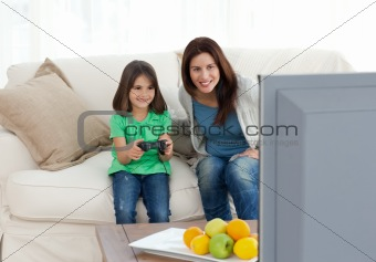 Mom and daughter playing video games together