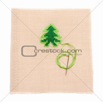 Green spruce on fabrics, needle
