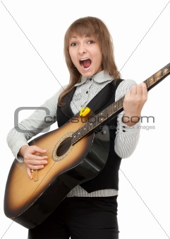 Girl with guitar in hand expressive sings