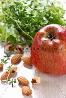 Apple, salad and nuts.
