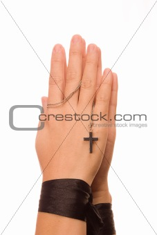 Woman is praying holding the cross
