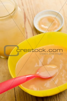 baby food in plastic bowl