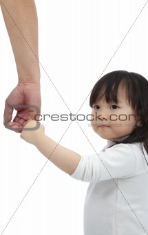 Little girl holding the hand of the father