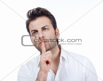 man in white shirt doing a silence gesture with forefinger - isolated on white