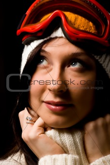 Cute woman with snowboard mask