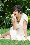Healthy young girl eating an apple outdoors