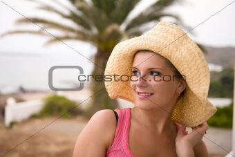 Portrait of young sexy romantic summer woman in large hat