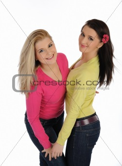 Two pretty girl friends having fun and laughing. isolated