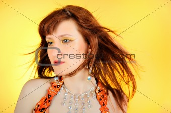 Beautiful mystic woman with golden make-up . yellow background