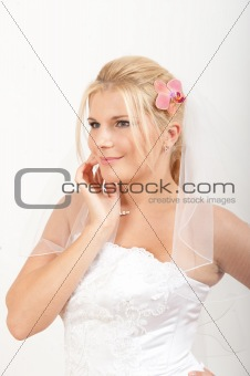 beautiful bride in white wedding dress smiling