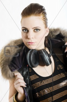 Portrait of young sexy party girl with headphones