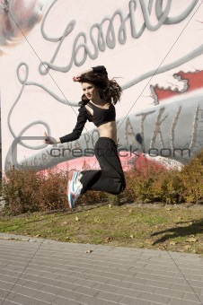 dancer young brunette jumping