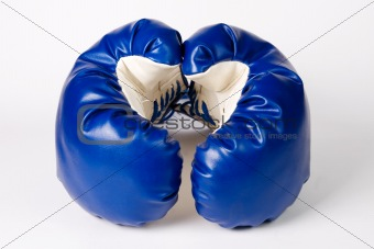 Pair of boxing gloves on white