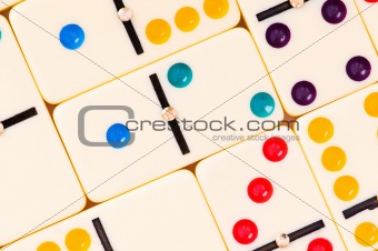 Colourful dominoes arranged at the background