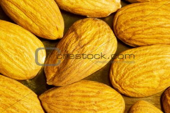 Fresh almonds arranged as a background