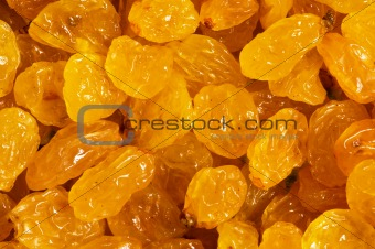 Background made of yellow dried raisins