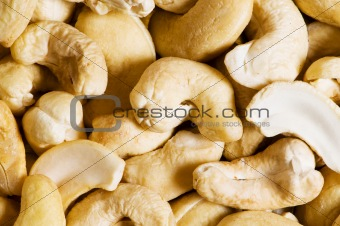 Cashew nuts arranged at the background