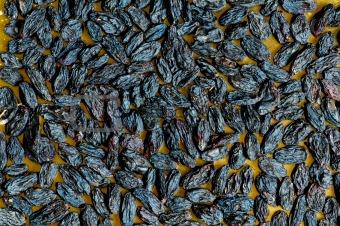 Background made of dark dried raisins